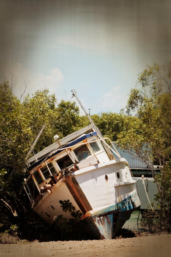 Grounded boat in need of some care Art Print