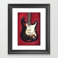 Burnt guitar Framed Art Print