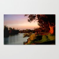 Reflecting sunset on the river Bank Canvas Print