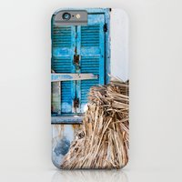 iPhone & iPod Case featuring Distressed Blue Wooden Shutters and Beach Umbrella in Crete. by Eyeshoot Photography