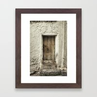 Retro door in mountains village Framed Art Print