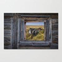 Old Farm Wagon viewed through a Barn Window on the Prairie Canvas Print