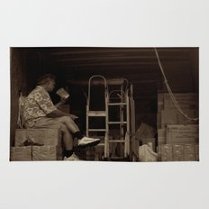 Man eating inside the van. Chinatown, New York City Rug