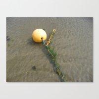 Yellow buoy bobbing on the sea Canvas Print