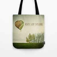 Never Stop Exploring ( A… Tote Bag
