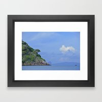 Long boat along the coast Framed Art Print