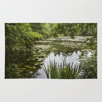 Water-lilies on a lake. Lynford, Norfolk, UK. Rug