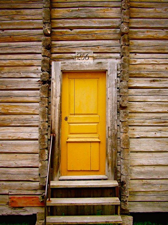 What lies behind the orange door? Canvas Print