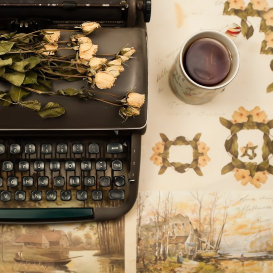 Little roses over an old typewriter and tea (Retro and Vintage Still Life Photography) Canvas Print
