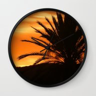Wall Clock featuring Palm Tree In Sunset by Phil Smyth