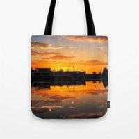 Sunrise arcross the water Tote Bag