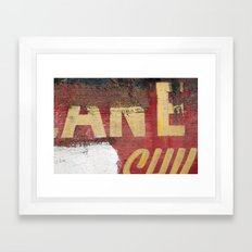 Yellow letters on red Framed Art Print