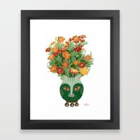Marigolds in cat face vase  Framed Art Print