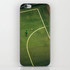 Kids are playing football on the green field iPhone & iPod Skin