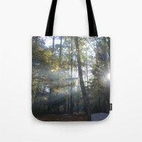 Sun Peaking Through Wood… Tote Bag