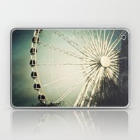 The Wheel Goes Round And… Laptop & iPad Skin