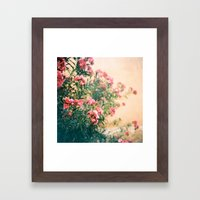 pink flowers in front of yellow wall Framed Art Print