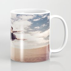 Beautiful Ballet Dancer Leaping Through The Sky Over The Desert  Mug