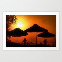 Beach umbrellas at sunrise Art Print