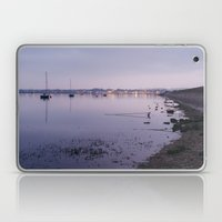 Boats and distant harbour reflected at twilight. Wells-next-the-sea, Norfolk, UK. Laptop & iPad Skin