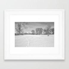 Footprints in the snow Framed Art Print