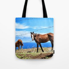 Horses against a blue sky Tote Bag