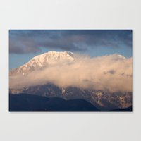In the shadow of the mountain peak Canvas Print