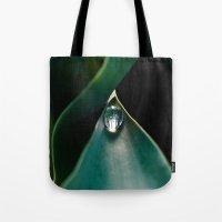 A drop caught Tote Bag