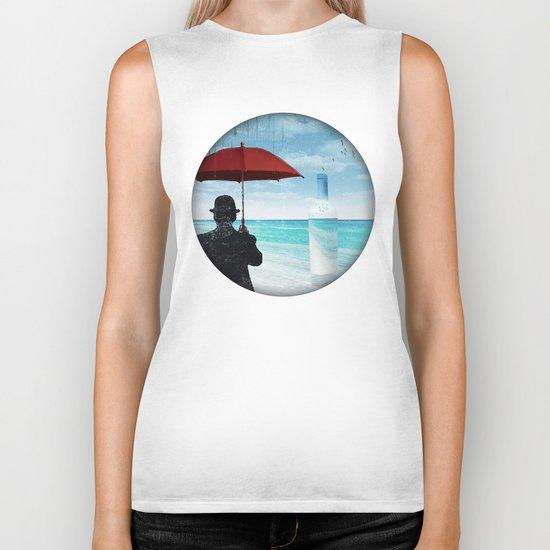 Chaplin at the beach in the rian Biker Tank
