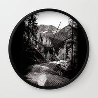 The road through the forrest below the mountains Wall Clock