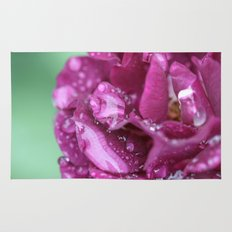 Flower with rain drops Rug