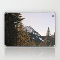 Snow Mountain In The Tre… Laptop & iPad Skin