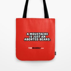 A MOUSTACHE IS JUST AN ABORTED BEARD. Tote Bag