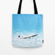 Plane through clouds Tote Bag