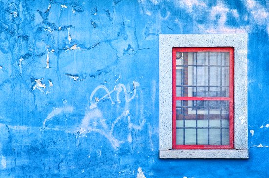 Window with red frame on blue wall Art Print