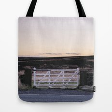 White gate leading to moorland at twilight. Derbyshire, UK. Tote Bag