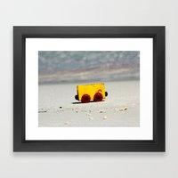 Toy on the beach Framed Art Print