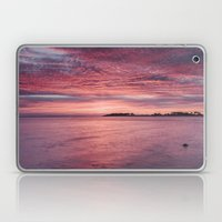 Pink dawn sky reflected in the surface of the sea. Norfolk, UK. Laptop & iPad Skin