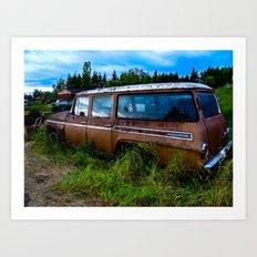 Old car resting in a field Art Print