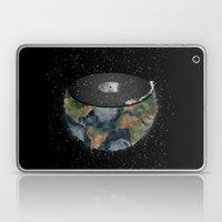 It makes the world go round. Laptop & iPad Skin
