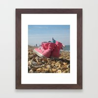 Pink shoes relaxing on the beach Framed Art Print