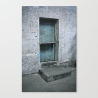 What's behind the old blue door? Canvas Print