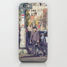 man in helmet stares wistfully across a busy intersection... iPhone 6s Slim Case