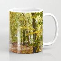 Remote country road through Autumnal woodland. Norfolk, UK. Mug