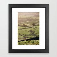 Hazy light at sunset over a valley of fields. Derbyshire, UK. Framed Art Print