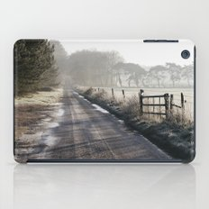 Remote frozen country road a t sunrise. Norfolk, UK. iPad Case