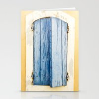 Blue wooden shutter in yellow wall. Stationery Cards