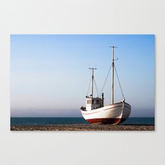 Fishing boat pulled up on beach Canvas Print