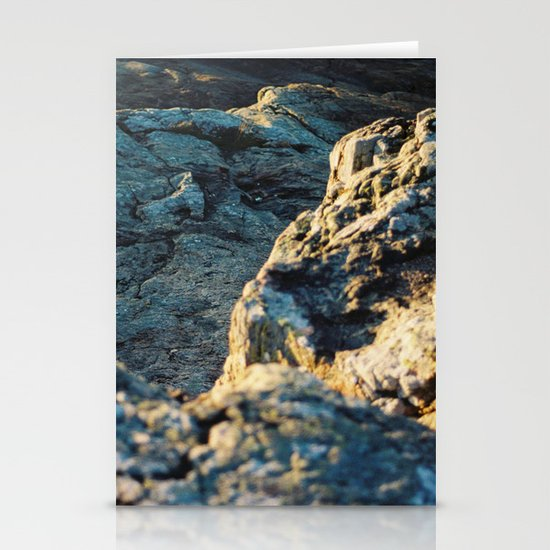 The sun is setting over the rocks Stationery Card
