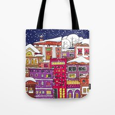 Winter town with falling snow. Tote Bag